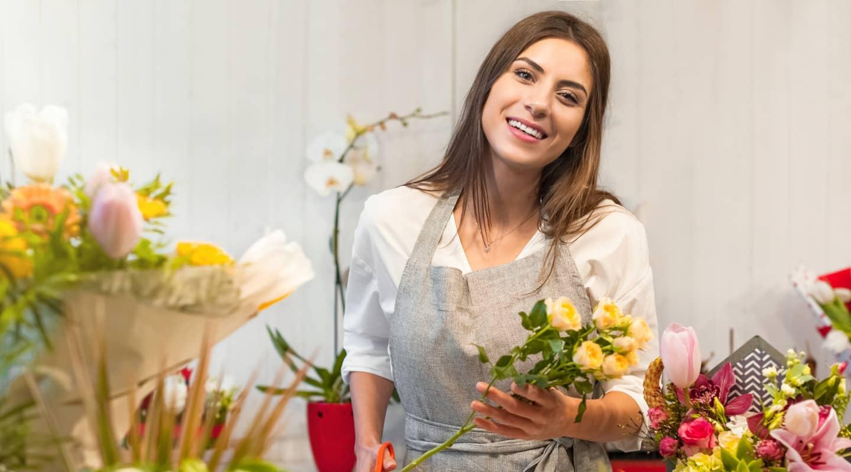 Florist arranging a bouquet of flowers